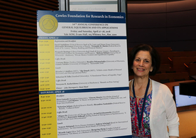Event coordinator Darlene Smith with 2018 GE Conference schedule poster